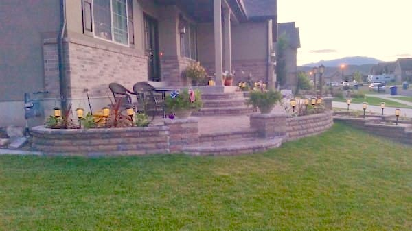With the flowers and paving stones all in places, and the lights installed, his transformed front yard was complete!