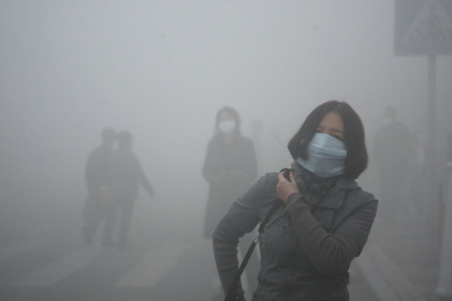 Girl Walks Through Smog In Beijing, Where Small-Particle Pollution Is 40 Times Over International Safety Standard