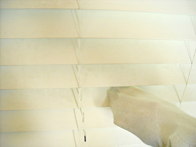 Use an orphan sock to clean blinds.